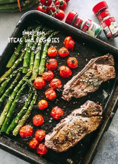 Steak and Veggies Sheet Pan Dinner - Perfectly seasoned sirloin steak, tender asparagus, and cherry tomatoes prepared together on just one sheet pan.