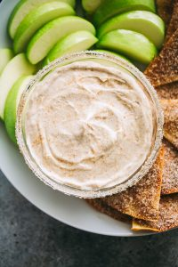 Skinny Churro Cream Cheese Fruit Dip - Lightened-up creamy fruit dip loaded with that amazing cinnamon sugar churros flavor that is sure to satisfy your cheesecake cravings!