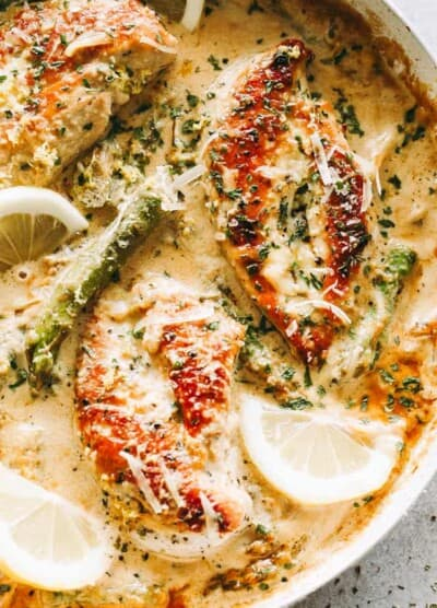 One Skillet Creamy Lemon Chicken with Asparagus - Delicious, bright, and simple, this lemon chicken recipe is the perfect easy weeknight meal made entirely in just one skillet and in under 30 minutes. The creamy sauce with the seared chicken and asparagus is a mouthwatering combination that everyone loves!