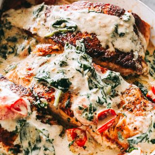Creamy Pan Seared Salmon with Tomatoes and Spinach