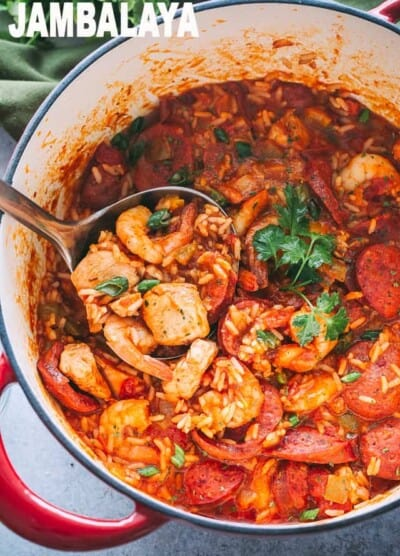 Jambalaya Recipe - Easy, tasty, one pot recipe for Jambalaya prepared with rice, chicken, shrimp, and sausages. Whip up this Southern favorite in just 30 minutes and get ready for a Mardi Gras dinner that the whole family will love!