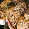 Skillet Bourbon Steak Recipe - Pan seared juicy sirloin steaks prepared with a dijon mustard rub and an incredible creamy bourbon sauce. A one pan recipe that is SO simple and SO darn delicious!