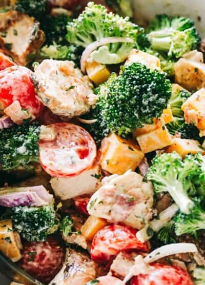 Creamy Broccoli Salad Recipe - Simple, easy, and delicious broccoli salad loaded with cheese, chicken, and bacon tossed with a creamy and flavor packed dressing. It is the perfect side to bring to a picnic or a potluck.