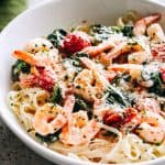 Creamy Shrimp Fettuccine with Spinach and Tomatoes Recipe - For a quick and delicious weeknight dinner, whip up this shrimp fettuccine coated in a light and creamy sauce prepared with spinach and cherry tomatoes!