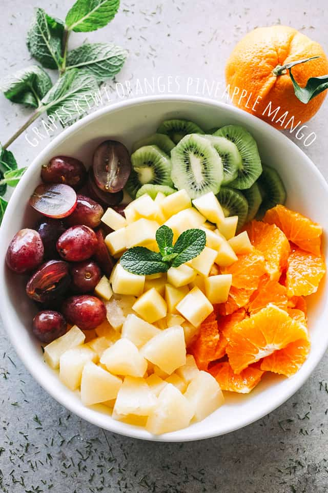 fruit salad, mango, pineapple, kiwi, grapes, oranges