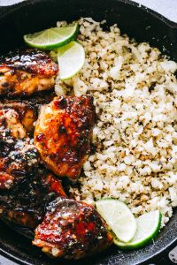 Honey Sriracha Chicken with Cauliflower Rice Recipe - Flavor-loaded, sweet and spicy honey sriracha chicken served with a delicious side of cauliflower rice.