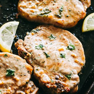 Pork Chops and Potatoes Sheet Pan Dinner Recipe - Oven baked pork chops marinated in soy sauce with garlic, and prepared on a sheet pan alongside seasoned and garlicky yukon potatoes. One pan, only a handful of ingredients, and 5-minutes prep time is all you will need to make this amazing pork chops recipe!