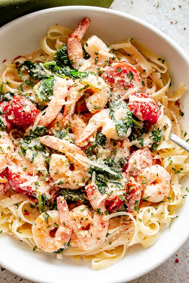 Shrimp, tomatoes, and spinach over fettuccine.