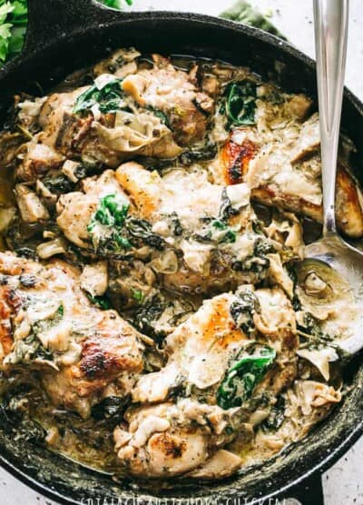 Spinach Artichoke Chicken Recipe - Easy, delicious, and rich skillet dinner prepared with seared chicken breasts, fresh spinach, flavorful artichokes, and an amazing creamy cheese sauce. Quick and easy enough for a weeknight meal, but also great for a special dinner party.