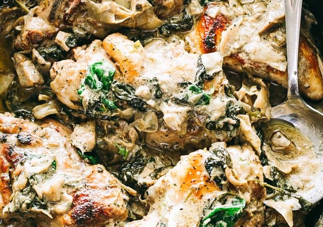 Spinach Artichoke Chicken Recipe - Easy, delicious, and rich skillet dinnerprepared with seared chicken breasts, fresh spinach, flavorful artichokes,and an amazing creamy cheese sauce. Quick and easy enough for a weeknight meal, but also great for a special dinner party.