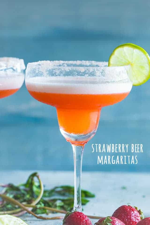 A delicious and pretty twist to the classic Beer Margarita prepared with fresh strawberries, tequila, and beer. The amazing combination of beer and margaritas makes for the perfect cocktail, and if you're looking for an easy party drink, look no further than our Strawberry Beer Margaritas.