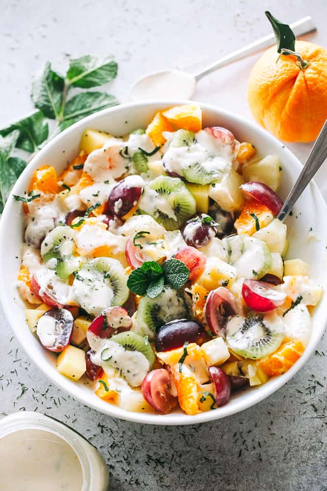 Easy Fruit Salad with Honey Orange Yogurt Dressing Recipe - A fabulous and healthy fruit salad featuring a rainbow of your favorite tropical fruits tossed with a wonderfully sweet and creamy yogurt dressing.