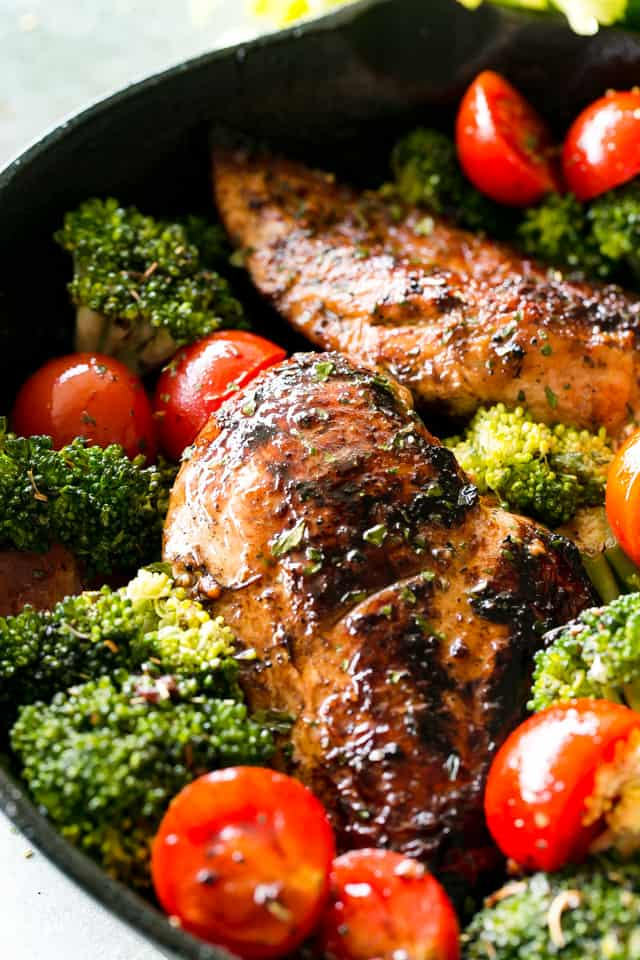 One Skillet Honey Balsamic Chicken and Veggies - One pan and 30 minutes is all you will need to make this juicy and tender chicken dish with veggies, coated in a wonderfully sweet and tangy honey balsamic sauce.