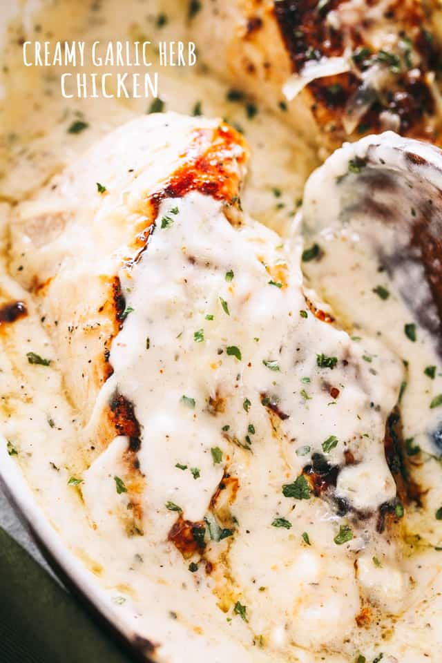 Creamy Garlic Herb Chicken Recipe - Pan-seared chicken breasts prepared with a creamy, garlicky herb sauce. Flavorful, quick weeknight dinner prepared in one pan and in 30 minutes!