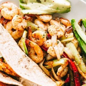 Skillet Shrimp Fajitas Recipe - Sizzling hot fajitas with juicy shrimp, flavorful bell peppers and onions, all tossed in a homemade fajitas seasoning mix. This is an easy, quick, and delicious shrimp fajitas dinner prepared in just one skillet!