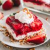 Strawberry Pretzel Dessert Recipe - Crunchy pretzel crust topped with a layer of sweet cream cheese with nuts and a delicious strawberry jello topping.