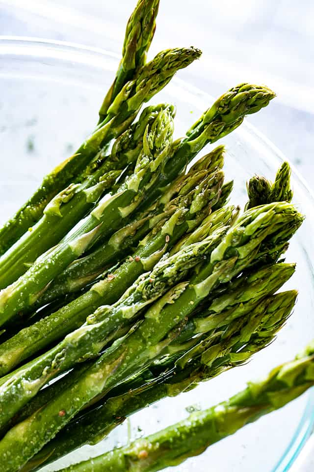 Grilled Asparagus Recipe - Grilled spears of fresh asparagus prepared with just a few ingredients, plus a sprinkle of parmesan cheese and a squeeze of lemon juice.