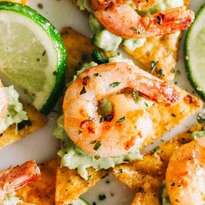 Cajun Shrimp and Guacamole Tortilla Bites - Crispy tortilla chips topped with guacamole andthe best tender and juicy cajun shrimp! Super easy and delicious appetizer that's perfect for summer cookouts or game day parties.