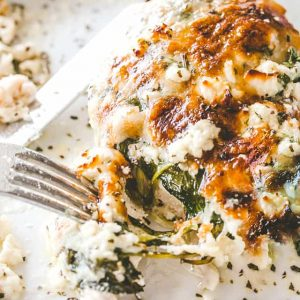 Cheesy Chicken Spinach Bake - Tender baked chicken breasts topped with creamy spinach and melty cheese. A one-pot low carb dinner that's perfect for those busy weeknights!