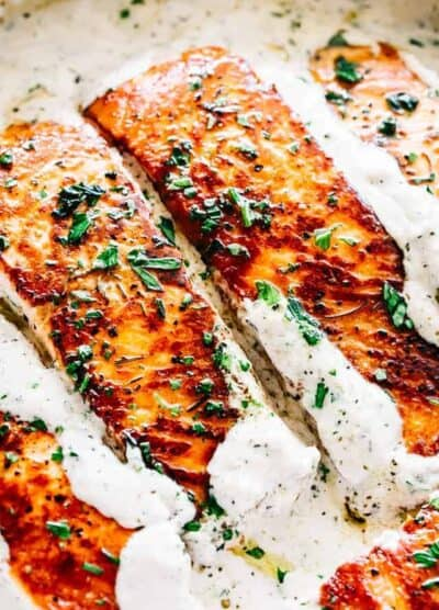 Pan Seared Salmon with Lemon Garlic Cream Sauce - Quick, delicious, bright and creamy salmon dinner prepared in just one skillet and served with an incredible lemon garlic cream sauce!All you needis about 20 minutes and a handful of ingredients.