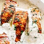 Pan Seared Salmon with Lemon Garlic Cream Sauce - Quick, delicious, bright and creamy salmon dinner prepared in just one skillet and served with an incredible lemon garlic cream sauce! All you need is about 20 minutes and a handful of ingredients.