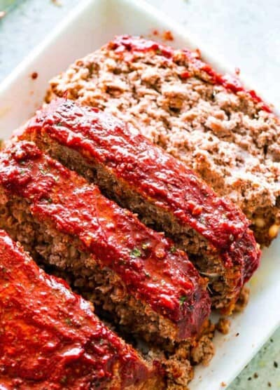 Easy Meatloaf Recipe - Stuffed with feta cheese and topped with a delicious sweet and tangy glaze, this is the absolutely best meatloaf recipe that comes together in just a few quick and easy steps.