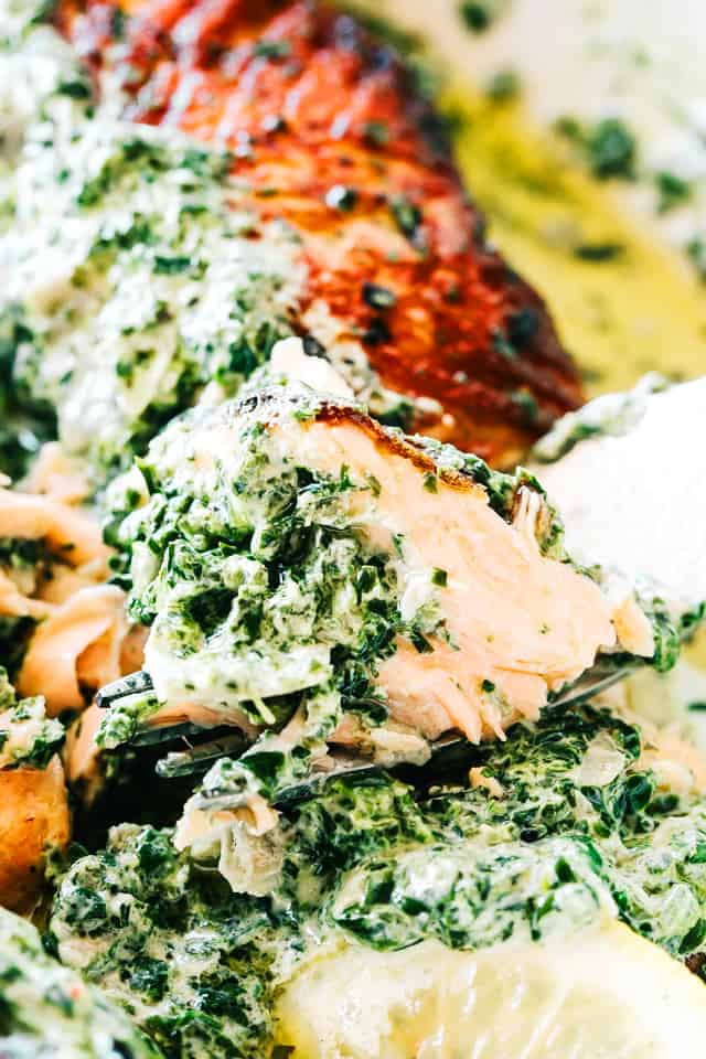 Stuffed Salmon with Spinach and Artichoke Dip - Easy and quick to make, absolutely incredible pan-seared salmon fillets stuffed with a deliciously creamy spinach and artichoke dip.
