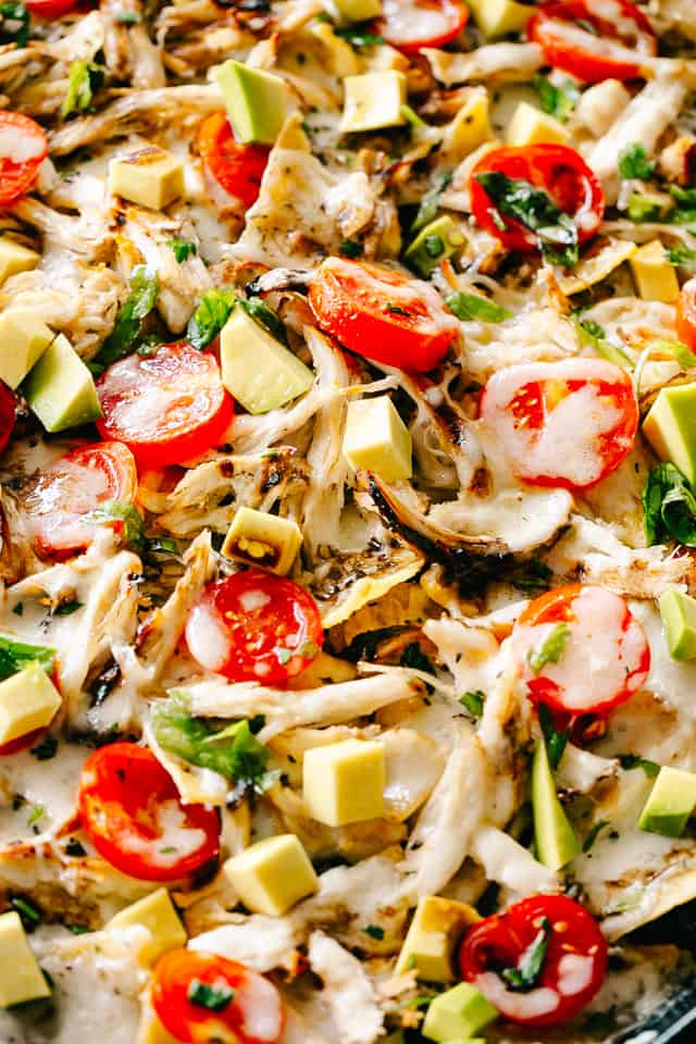 Caprese Chicken Nachos- Easy, super cheesy, and amazingly delicious Caprese Chicken Nachos loaded with mozzarella cheese, shredded balsamic chicken, sweet tomatoes, and fresh basil.