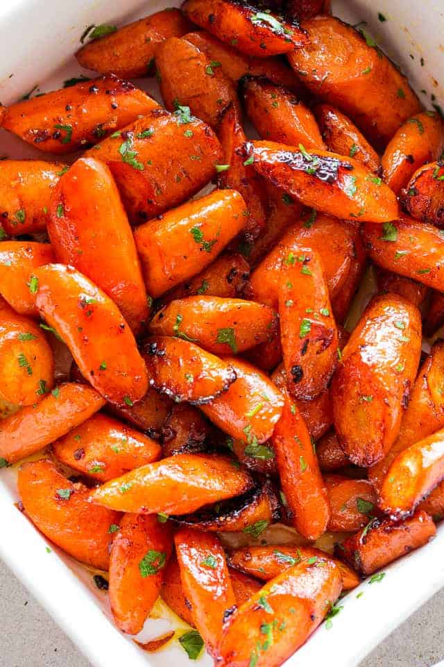 Honey Garlic Butter Roasted Carrots Recipe - Easy, simple, wonderfully delicious roasted carrots prepared with the most incredible garlic butter and sweet honey sauce.