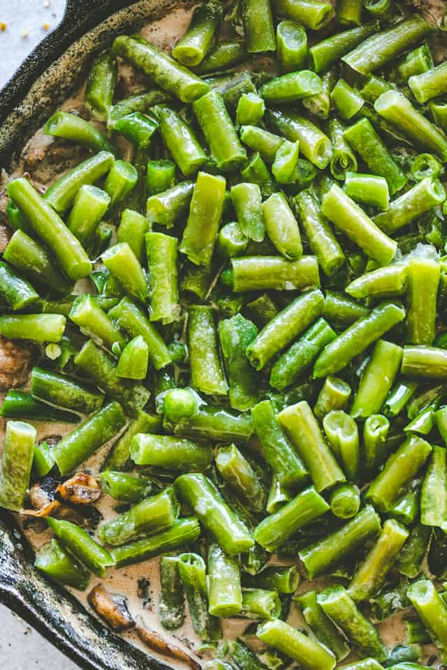 Green Bean Casserole Recipe - Creamy, flavorful and delicious Green Bean Casserole prepared with a rich mushroom gravy and made completely from scratch.
