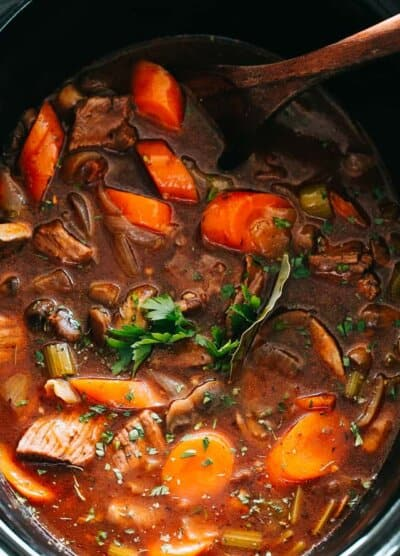 Slow Cooker Beef Stew - Rich and hearty stew packed with melt in your mouth beef chunks and veggies, and slow cooked to a crazy delicious and tender perfection. This is a recipe that you'll go back to again and again.