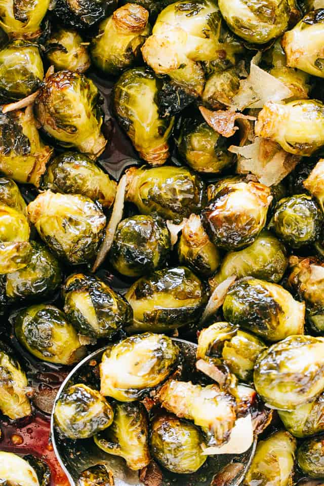 Oven Roasted Brussels Sprouts with Honey Balsamic Glaze - Roasted, crispy and delicious brussels sprouts coated with an amazing honey balsamic glaze!This easy to make Oven Roasted Brussels Sprouts Recipeis the perfect side dish that belongs on your Thanksgiving table.