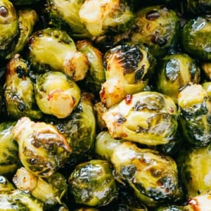 Oven Roasted Brussels Sprouts with Honey Balsamic Glaze - Roasted, crispy and delicious brussels sprouts coated with an amazing honey balsamic glaze! This easy to make Oven Roasted Brussels Sprouts Recipe is the perfect side dish that belongs on your Thanksgiving table.
