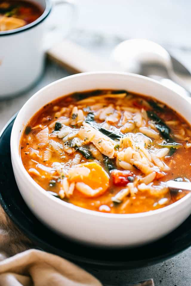 Leftover Turkey Soup Recipe with Orzo and Spinach - Delicious and hearty soup loaded with tomatoes, spinach, orzo pasta, and turkey meat. Make a pot of this homemade, healthy, and real easy Turkey Soup with your Thanksgiving leftovers.