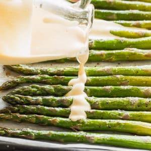 Pouring Hollandaise Sauce over Asparagus