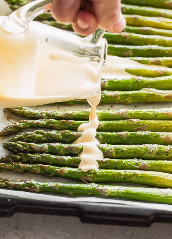 Pouring Hollandaise Sauce over Asparagus