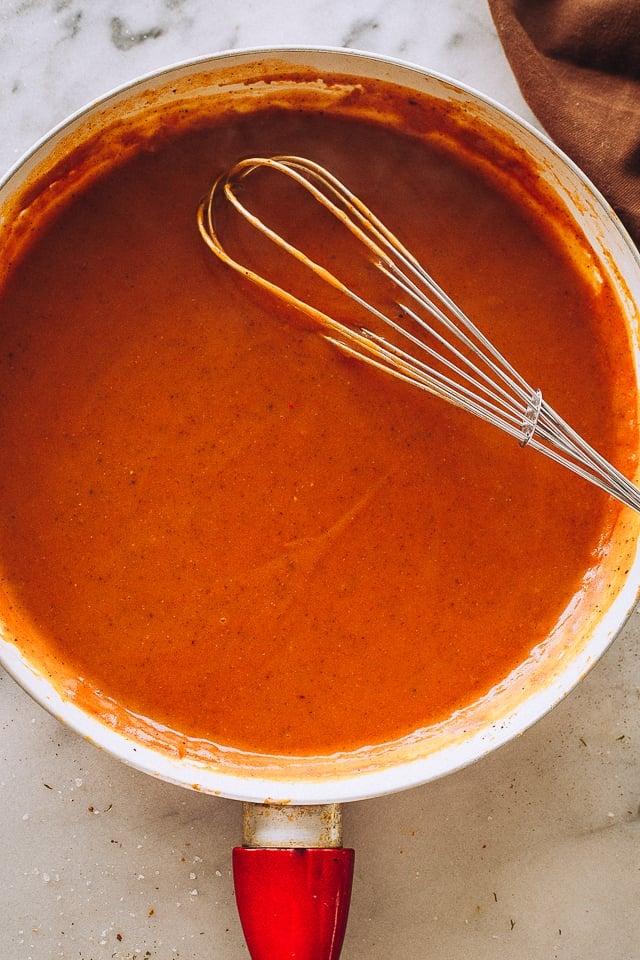 Enchilada Sauce in a skillet.