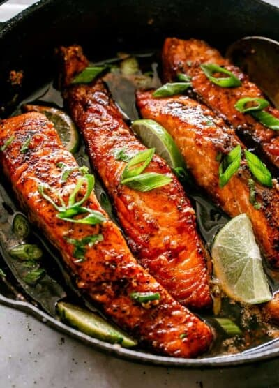 Honey Garlic Salmon Fillets in a cast iron skillet.