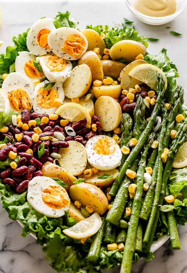 Spring salad with eggs, asparagus, potatoes, and beans.