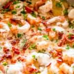 Cooking shrimp in a skillet.