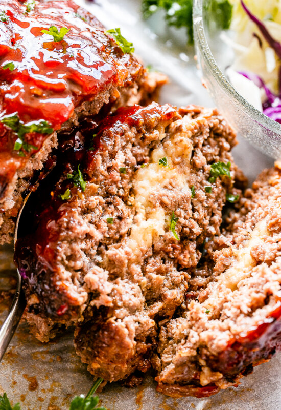 Slice of meatloaf stuffed with mozzarella cheese.