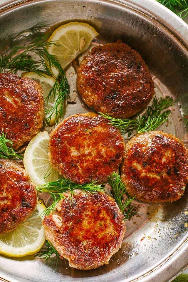Salmon patties on baking sheet.