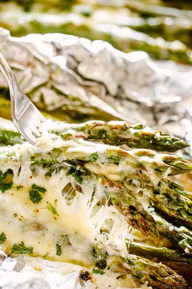 Cheesy Asparagus on a fork.