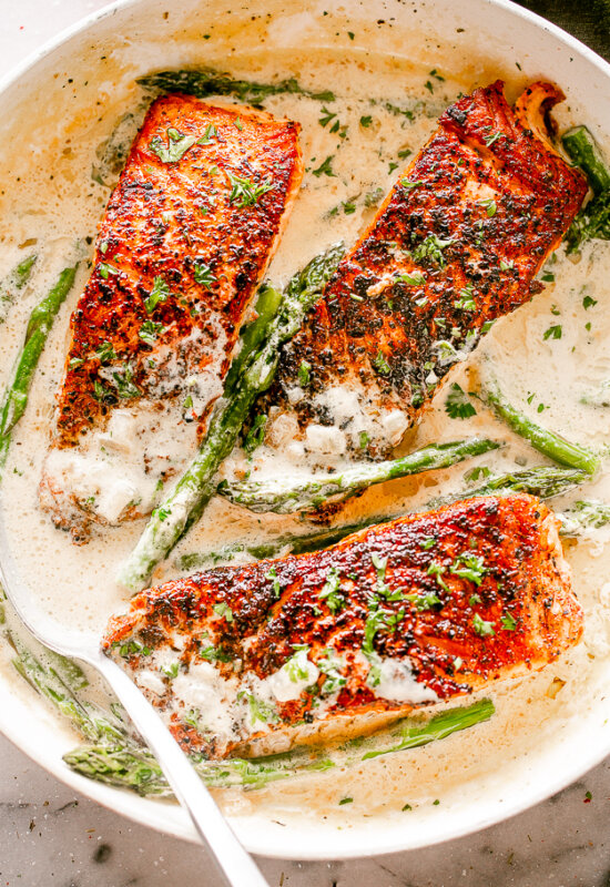 Salmon Fillets with Cream Sauce in a Skillet