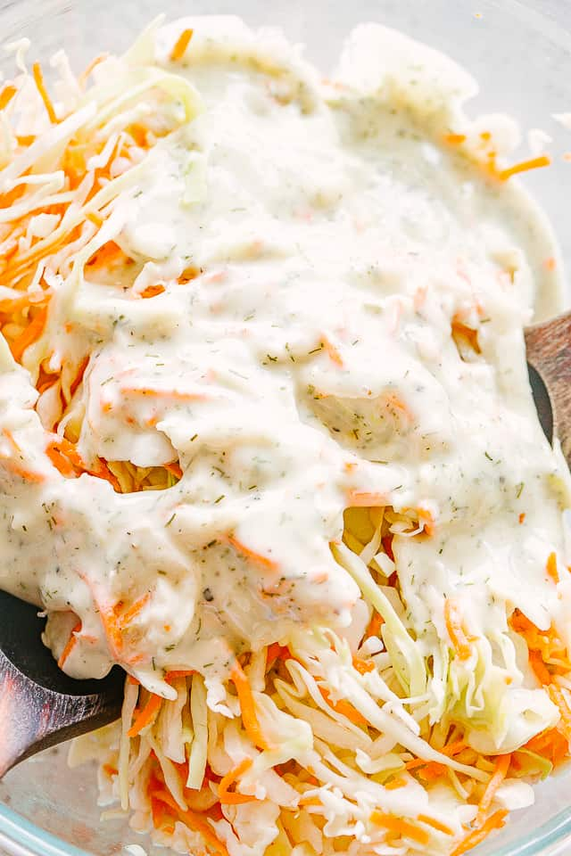 Mayonnaise salad dressing poured over shredded cabbage and carrots.