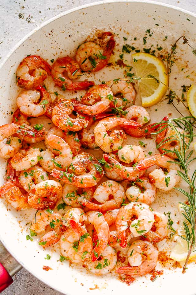 lemon herb garlic shrimp in a skillet.