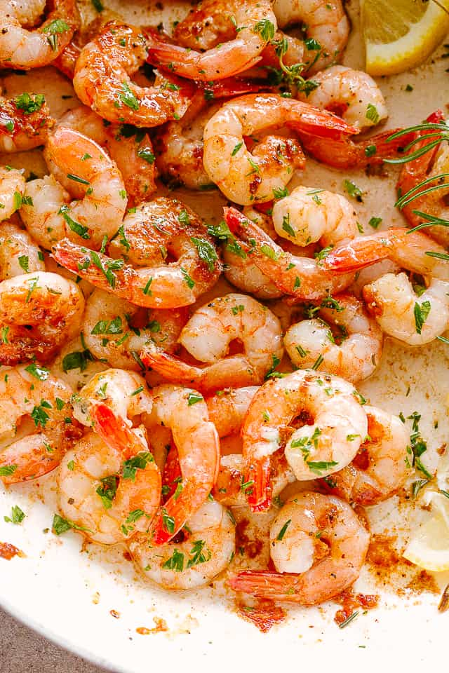 lemon garlic shrimp cooked in a pan.