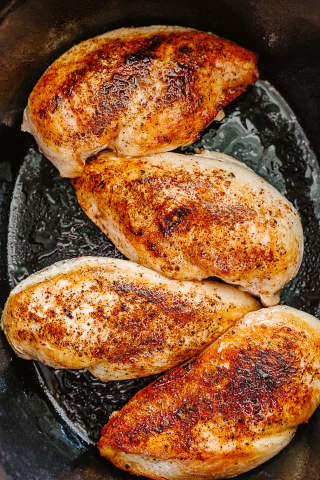 Browned chicken breasts in a slow cooker