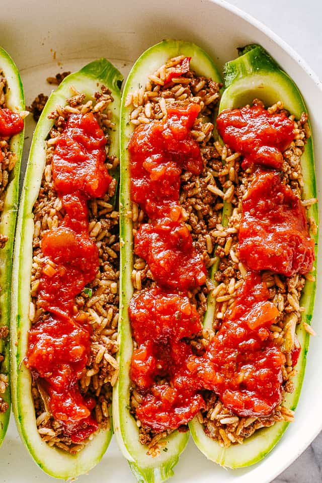 Fresh zucchini stuffed with meat and topped with pasta sauce.