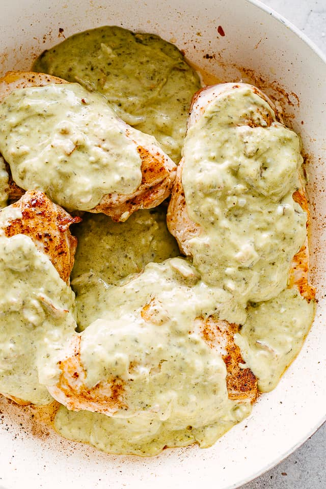 Alfredo Sauce and Basil Pesto poured over chicken breasts.